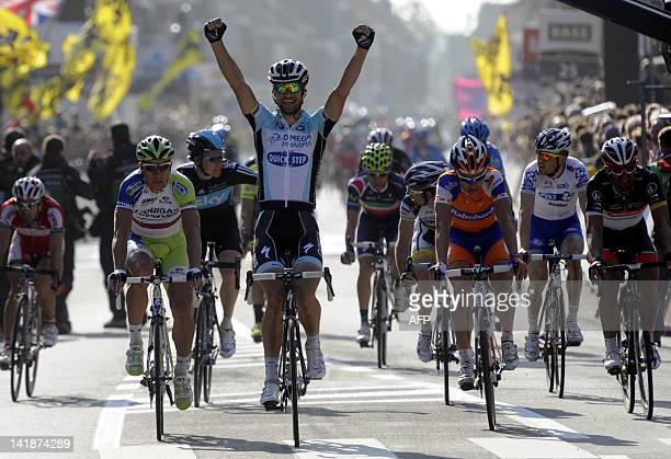 Belgian Tom Boonen of team Omega Pharma - Quick Step celebrates as he wins ahead of Slovak Peter Sagan of Liquigas-Cannondale during the 74th edition...