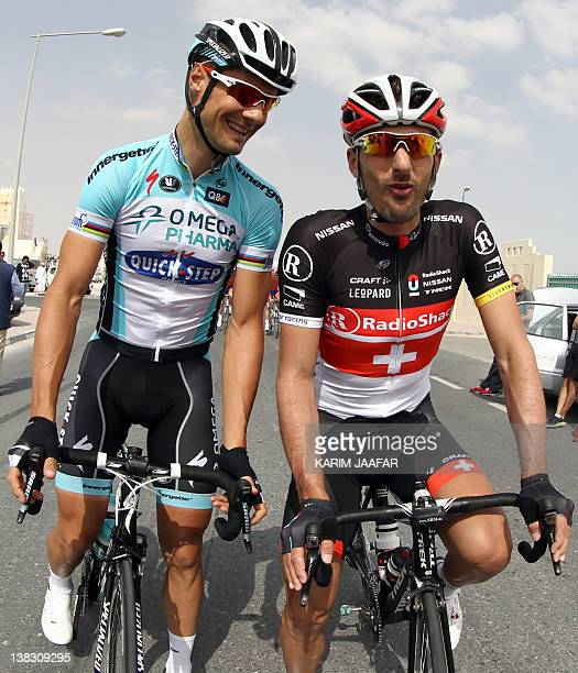 Belgian Tom Boonen of team Omega PharmaQuick Step speaks with Fabian Cancellara of Switzerland before competing in the 1335 kilometer first stage of...