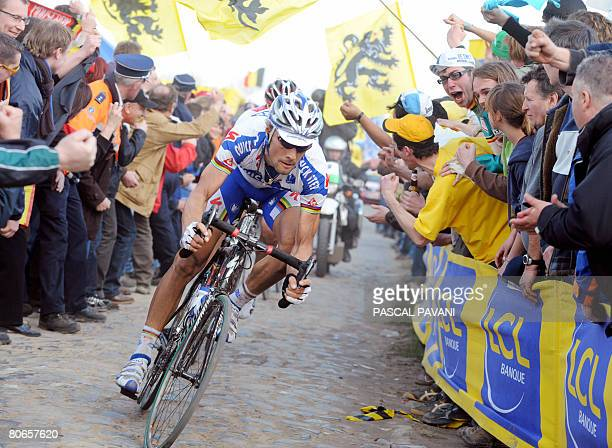 Belgian Tom Boonen rides on April 13 2008 on the cobblestone section 'The Dead Tree' during the 106th ParisRoubaix cycling race between Compiegne and...