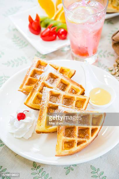 Belgian waffle with cream and icing sugar