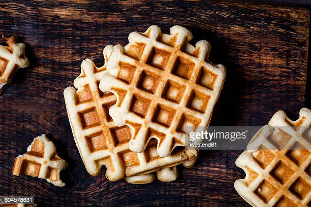 belgian waffles on dark wood - waffle stock photos and pictures