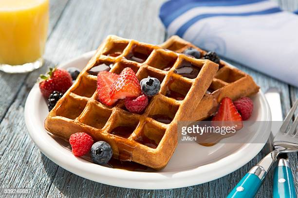 Belgian Waffles with Assorted Berries and Maple Syrup.