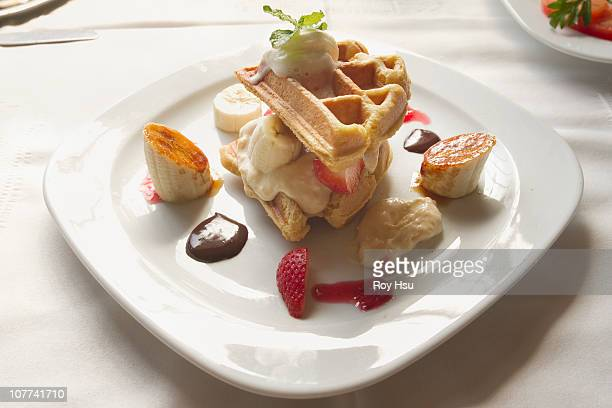 Belgian waffles with cream and fresh fruit