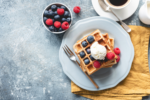 Belgian waffles with ice cream and berries 1033058306