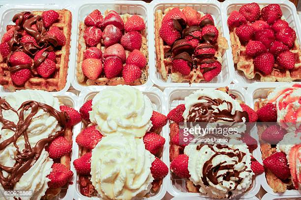 Belgian waffles with strawberries and cream