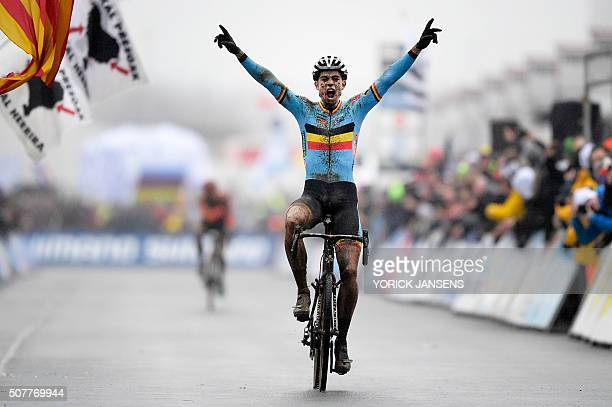 TOPSHOT Belgian Wout Van Aert celebrates as he crosses the finish line to win the men's elites race at the world championships cyclocross cycling in...