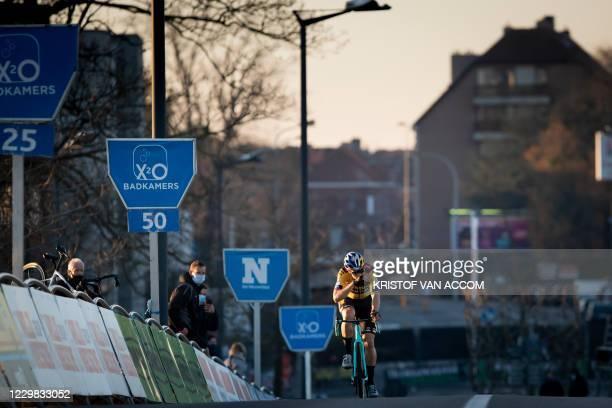 Belgian Wout Van Aert crosses the finish line at the Urban Cross Kortrijk women elite race, second race of the 'Trofee Veldrijden' trophy , in...