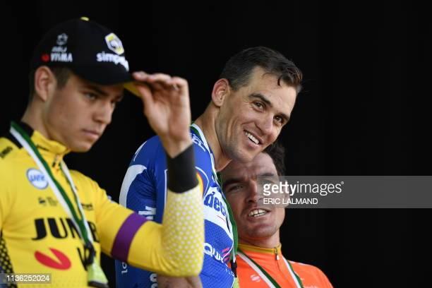 Belgian Wout Van Aert of Team JumboVisma Czech Zdenek Stybar of Deceuninck QuickStep and Belgian Greg Van Avermaet of CCC Team celebrate on the...