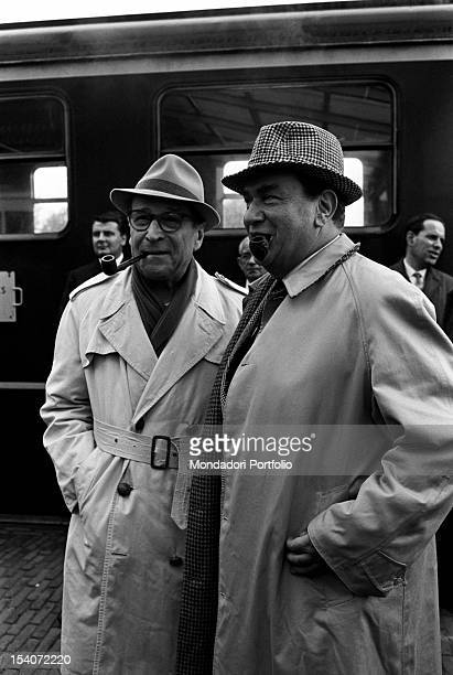 Belgian writer Georges Simenon smiling with Italian actor Gino Cervi who played Maigret. 1960s
