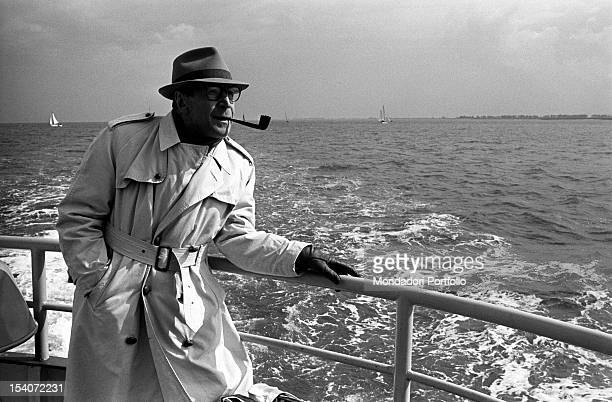 Belgian writer Georges Simenon smoking a pipe on a boat 1966