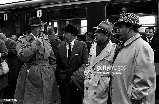 Belgian writer Georges Simenon talking at the train station with three actors who played Maigret There are British actor Rupert Davies Dutch actor...