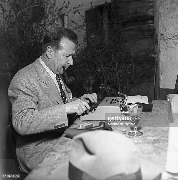 Belgian writer Georges Simenon typewriting Milan 1957