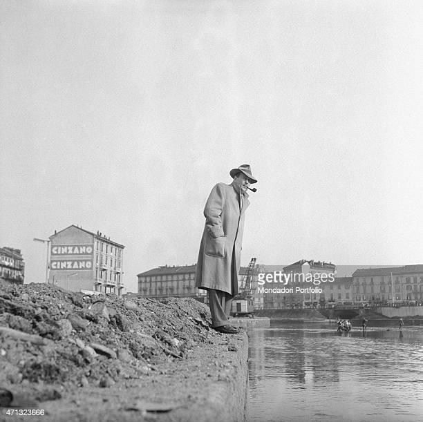 Belgian writer Georges Simenon watching the Darsena remembering him the Saint Martin Canal in Paris Milan 1957