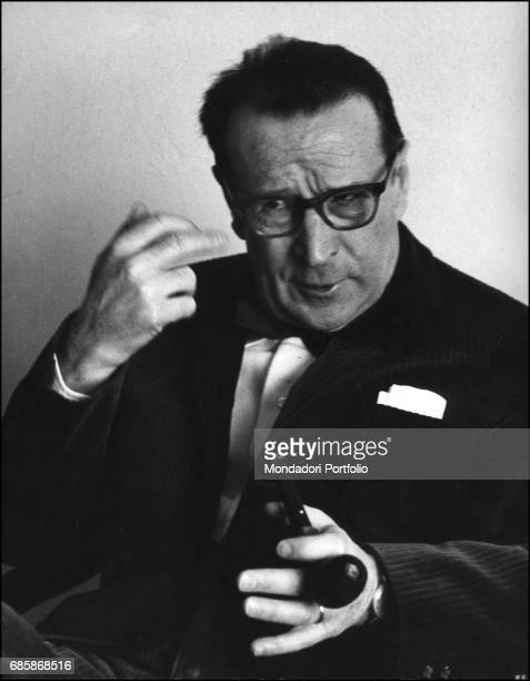 Belgian writer Georges Simenon with a pipe in his hand during a conversation. 1960s