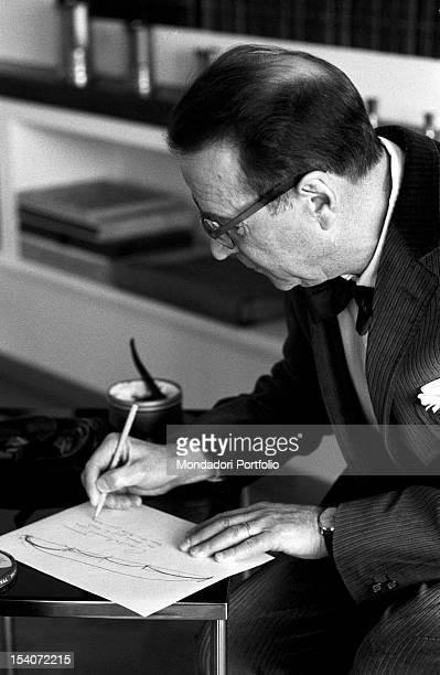 Belgian writer Georges Simenon writing 1960s