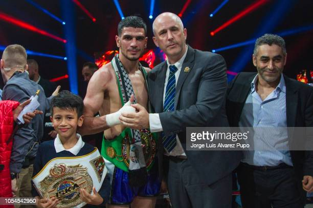 Belgian Youssef Boughanem poses with his son and the WBC Deputy Secretary General Kevin P Noone after his WBC title fight vs Kongjak Por Paoin of...
