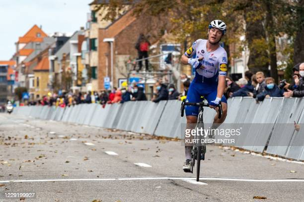 Belgian Yves Lampaert of Deceuninck - Quick-Step crosses the finish line to win the 44th edition of the men's elite race Driedaagse Brugge - De Panne...