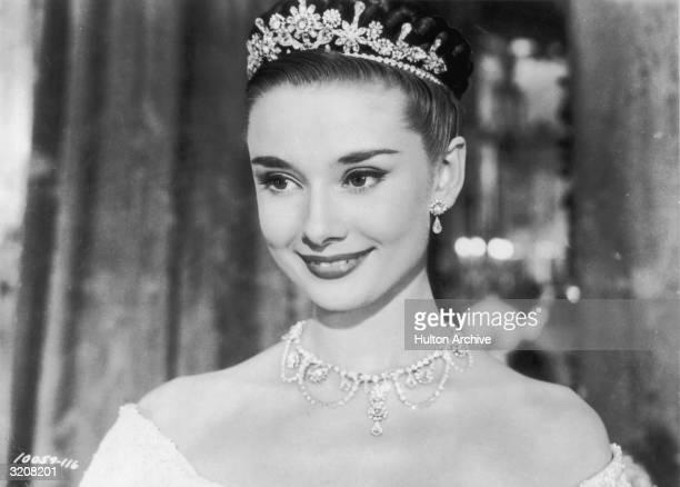 Belgianborn actor Audrey Hepburn wears a tiara in a headshot still from director William Wyler's film 'Roman Holiday'