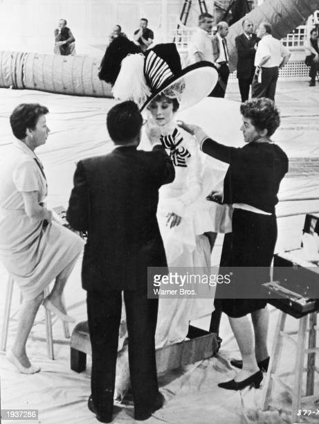 Belgianborn actor Audrey Hepburn wears an elaborate costume while having her makeup done on the set of 'My Fair Lady' directed by George Cukor 1964