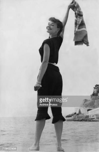 Belgianborn actress Audrey Hepburn in a black beach outfit circa 1955