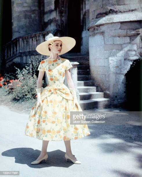 Belgianborn actress Audrey Hepburn in a floralprint day dress and sun hat circa 1955