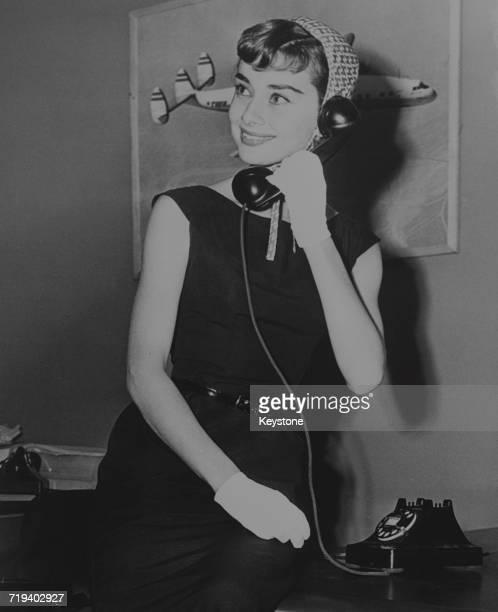 Belgianborn actress Audrey Hepburn makes a phone call circa 1953