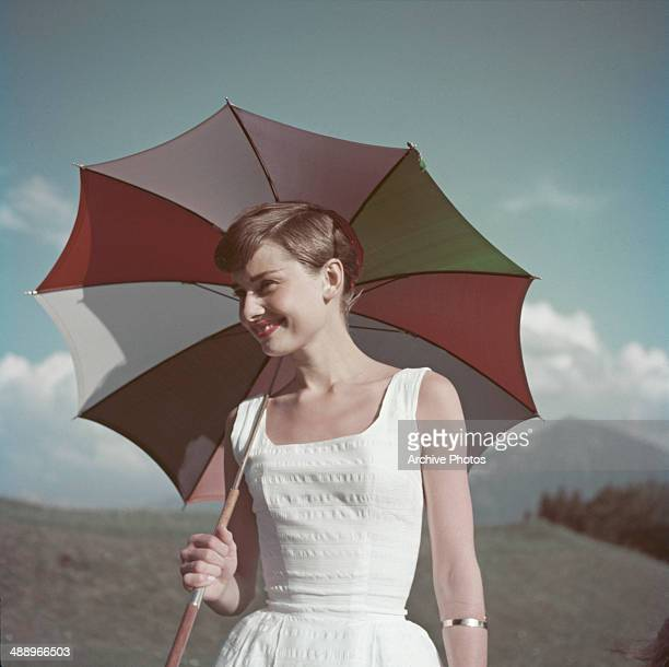 Actress Audrey Hepburn with an umbrella circa 1955