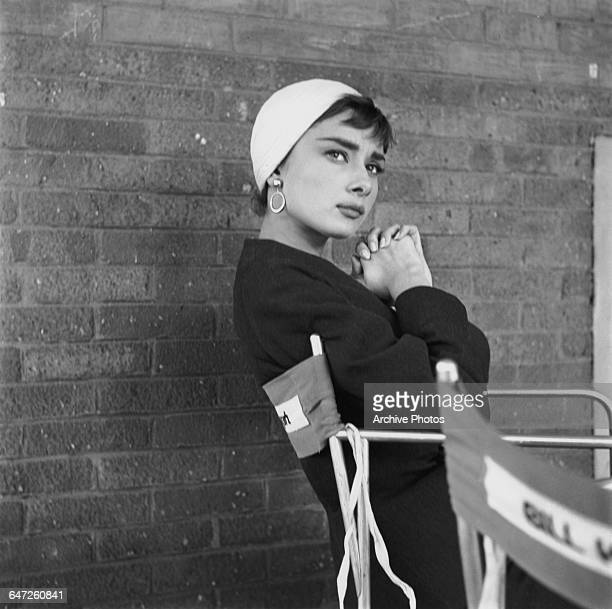 Belgianborn actress Audrey Hepburn on the set of director Billy Wilder's film 'Sabrina' New York October 1953 She is wearing a skirt suit and hat...