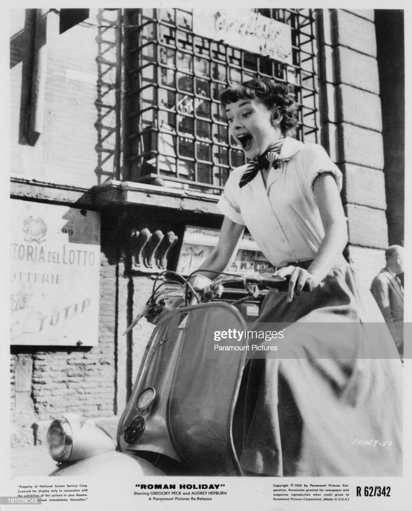 Belgian-born actress Audrey Hepburn (1929 - 1993) riding a motor scooter through Rome in a publicity still for 'Roman Holiday', directed by William Wyler, 1953.