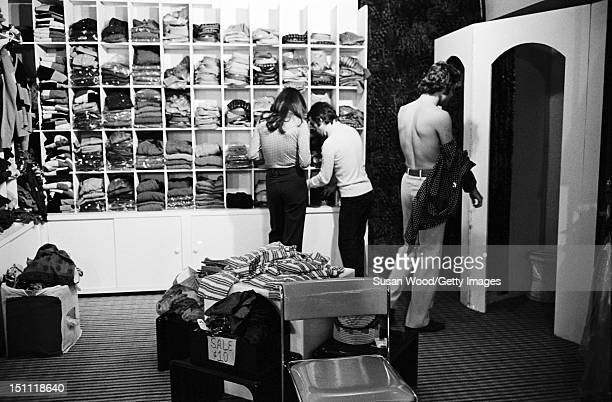 Belgianborn American fashion designer Diane von Furstenberg and her husband Swiss baron Egon von Furstenberg shop for clothes in an unspecified store...