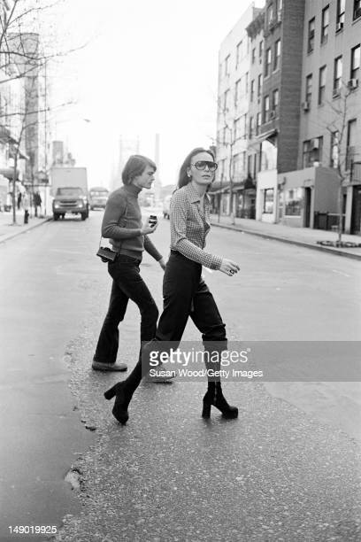 Belgianborn American fashion designer Diane von Furstenberg crosses a street New York New York January 1 1970 The man in background is the...