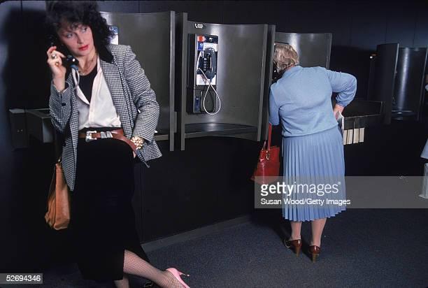 Belgianborn fashion designer Diane von Furstenberg talks on a pay phone at John F Kennedy Airport in Queens New York May 1979 Furstenberg is wearing...
