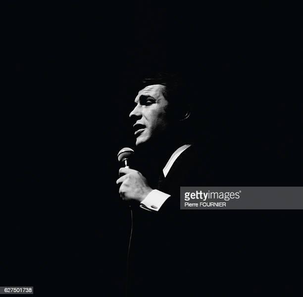 Belgian-born singer Adamo performs at the Olympia concert hall in Paris.