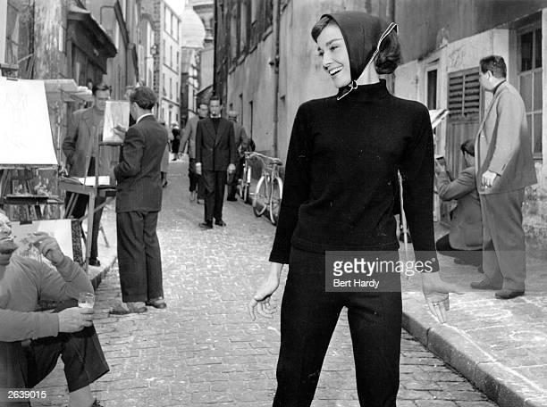 Belgianborn US actress Audrey Hepburn in a street at Paris during the filming of 'Funny Face' Original Publication Picture Post 8540 Audrey Dances...