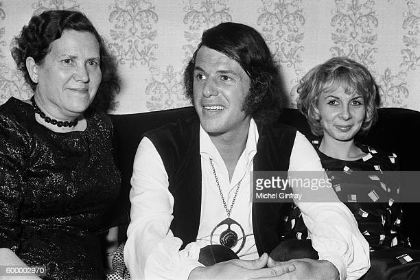 BelgianItalian singer and songwriter Salvatore Adamo surrounded by his mother Concetta and his wife Nicole