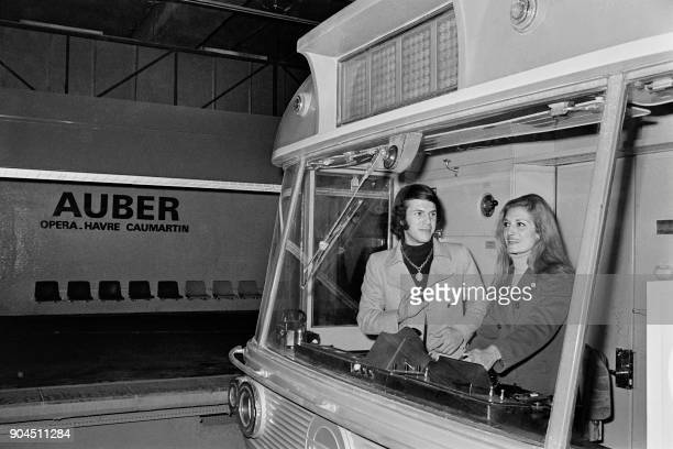 BelgianItalian singer Salvatore Adamo and French singer Dalida are seen in a train during the inauguration of the RER station Auber in Paris on...