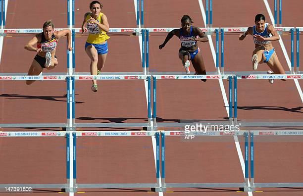 Belgian's Eline Berings Bosnian Gorana Cvijetic France's Aisseta Diawara and Italy's Marzia Caravelli compete in the women's 100m hurdles...