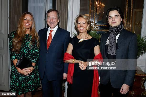 Belgium Ambassador to France Vincent Mertens de Wilmars and his wife MarieJoelle standing between Writer Delphine Marang Alexandre and her son Victor...