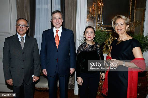 Belgium Ambassador to France Vincent Mertens de Wilmars his wife MarieJoelle Morocco's ambassador in France Chakib Benmoussa and his wife attend the...