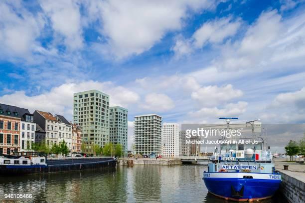 """Belgium, Antwerp - 1 May, 2015: View of the Verbindingsdok towards the Kattendijkdok in the Eilandje. Antwerp""""u2019s oldest port area is now a..."""