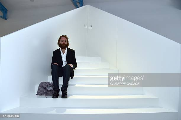 Belgium architect Cedric Libert poses on May 2 2015 in Milan in the new venue of the Prada's Foundation The new Milan venue of Foundation Prada opens...