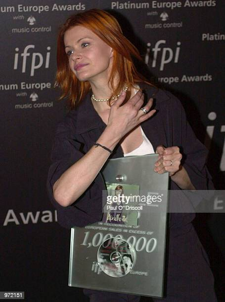 Belgium artist Axelle Red holds an award presented to her at the International Federation of Phonographic Industries fourth annual Platinum Europe...