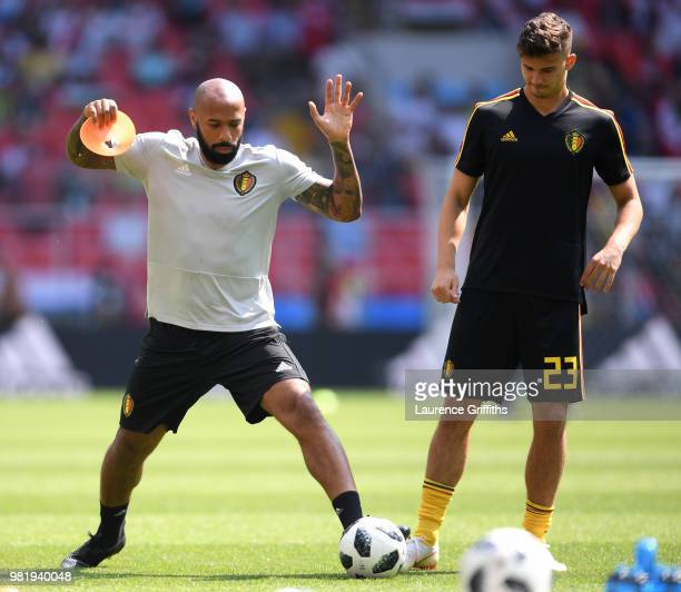 Belgium Assistant Manager Thierry Henry and Leander Dendoncker warm up prior to the 2018 FIFA World Cup Russia group G match between Belgium and...