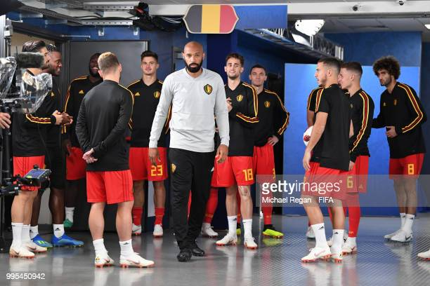 Belgium assistant manager Thierry Henry looks on from the tunnel before the warm up prior to the 2018 FIFA World Cup Russia Semi Final match between...