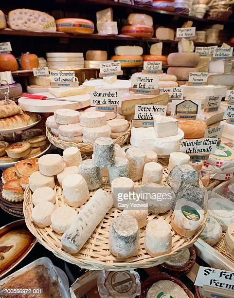 Belgium, Bruges, display of cheese in food shop