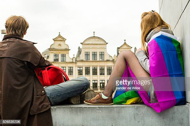 Belgium Brussels 19 May 2013 Boy and girl watch the parade form Kunstberg with typical Medieval houses in background About 80000 participants at the...