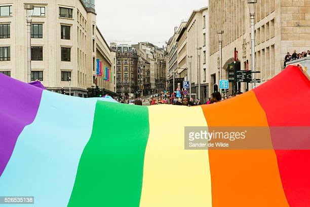 Belgium Brussels 19 May 2013 European gays wave a giant rainbow flag with typical Brussels architecture About 80000 participants at the Belgian Pride...