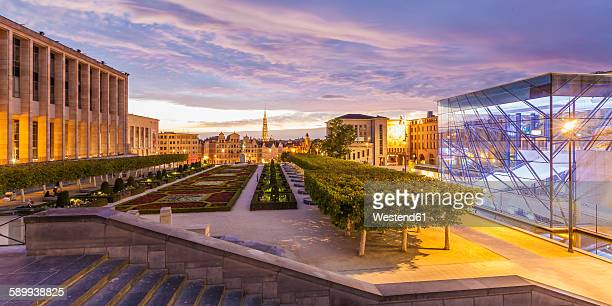 Belgium, Brussels, Mont des Arts, Congress Center Square, Glass Cube, park and townhall towerand lower city in the evening
