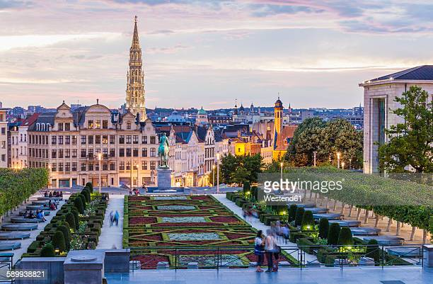 belgium, brussels, mont des arts, park and townhall tower, lower city in the evening - brussels capital region stock pictures, royalty-free photos & images