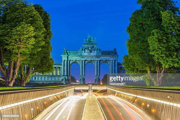 Belgium, Brussels, Parc du Cinquantenaire, Triumphal Arch, Avenue John Kennedy at night